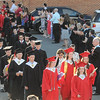 John Strickler - Digital First Media<br /> The Boyertown High School Class of 2016 walks between their teachers as they walk to their graduation ceremony. The teachers clapped and cheered their students.