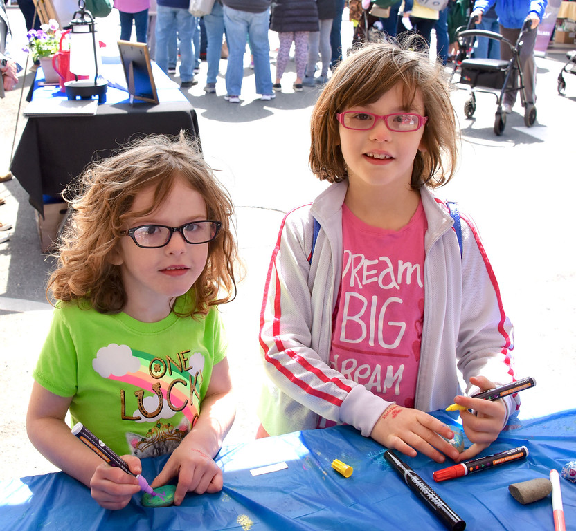 . Jesi Yost � For Digital First Media Abigail Kraemer, 6, and Evelyn Knappenberger, 8, of Gilbertsville paint rocks at Fleetwood Bank�s Coming Out of Hibernation stand.