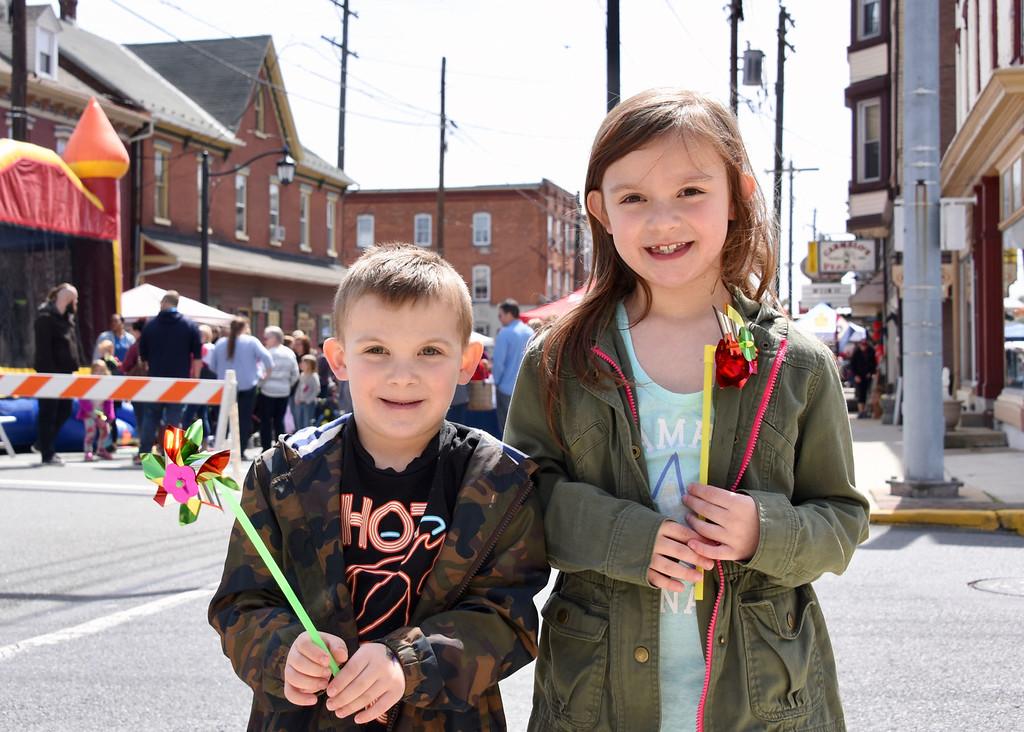 . Jesi Yost � For Digital First Media Frank Demarco, 5, and Brynn Demarco, 7, of Boyertown enjoy their pinwheels along Philadelphia Avenue.