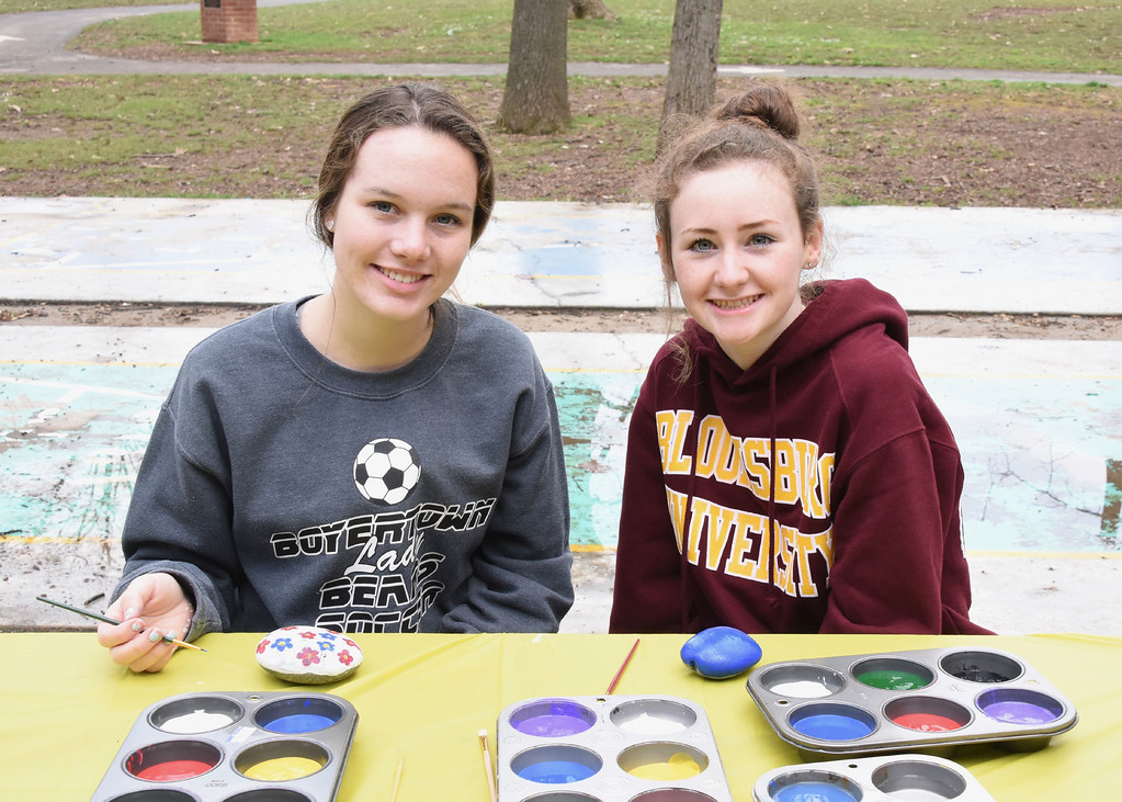 . Jesi Yost � For Digital First Media Boyertown Area High School CE Environmental Science seniors Montanna Robbins and Kaitlyn Oldham volunteer at the rock painting station at EarthFest.