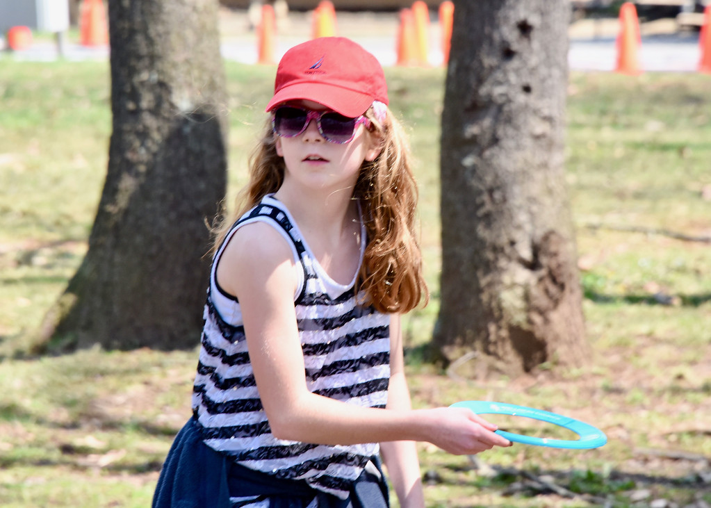 . Jesi Yost � For Digital First Media Jordan Miller, 12, of Barto, throws a Wellness Council of Boyertown flying disc at EarthFest.