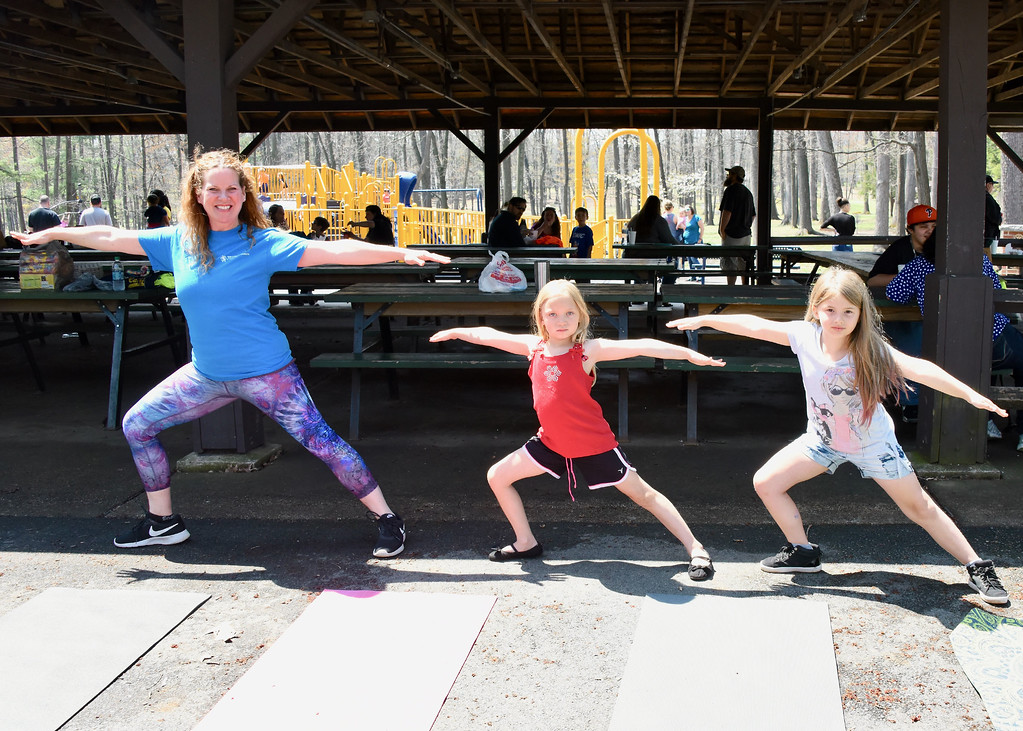 . Jesi Yost � For Digital First Media Yoga teacher Kristen Dion demonstrates the Warrior II pose to children at Earthfest.