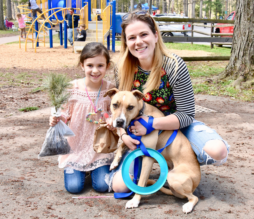 . Jesi Yost � For Digital First Media Bristol Ziegler, 7, of Colebrookdale Elementary School, attends EarthFest with her aunt, Samantha Johnson, and 2-year-old Pit Bull mix �Moose.�