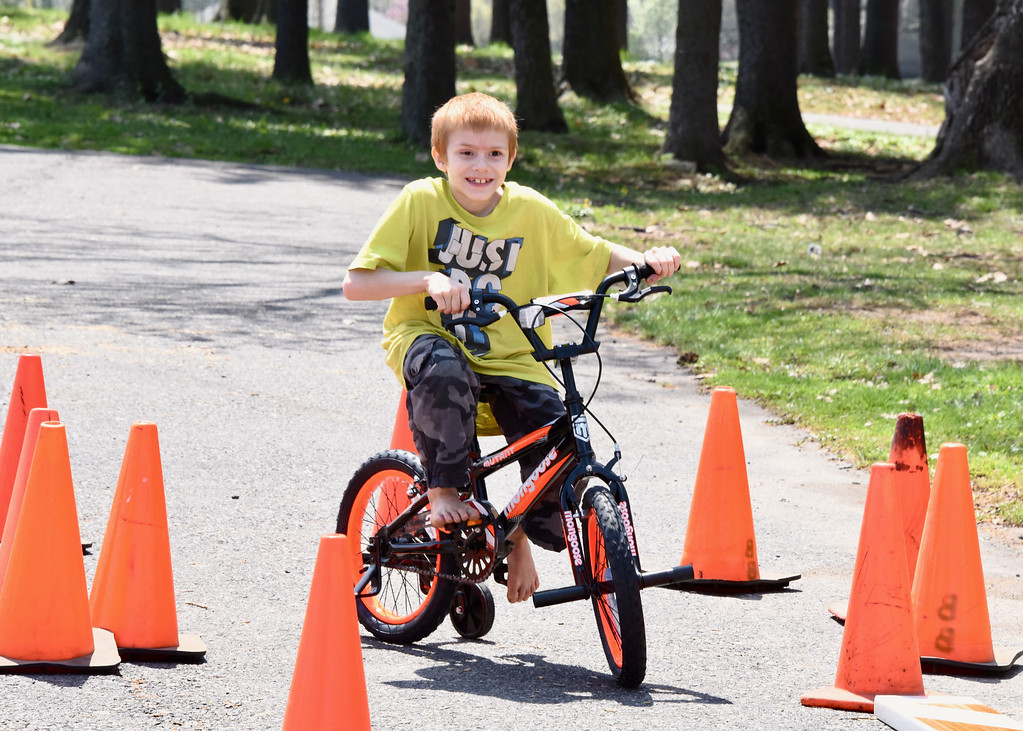 . Jesi Yost � For Digital First Media 8-year-old Zack Heffner maneuvers through a bicycle obstacle course. The Boyertown Police Department set up a bike safety and obstacle course. They provided bikes and helmets for children to use. Each child who peddles through the course earned an entry to win one of four bikes at the end of Eathfest.