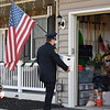 Plymouth Township Police chief Joseph Lawrence delivers a box from Meals on Wheels to the Fox family home in Gilbertsville.<br /> Marian Dennis -- Digital First Media