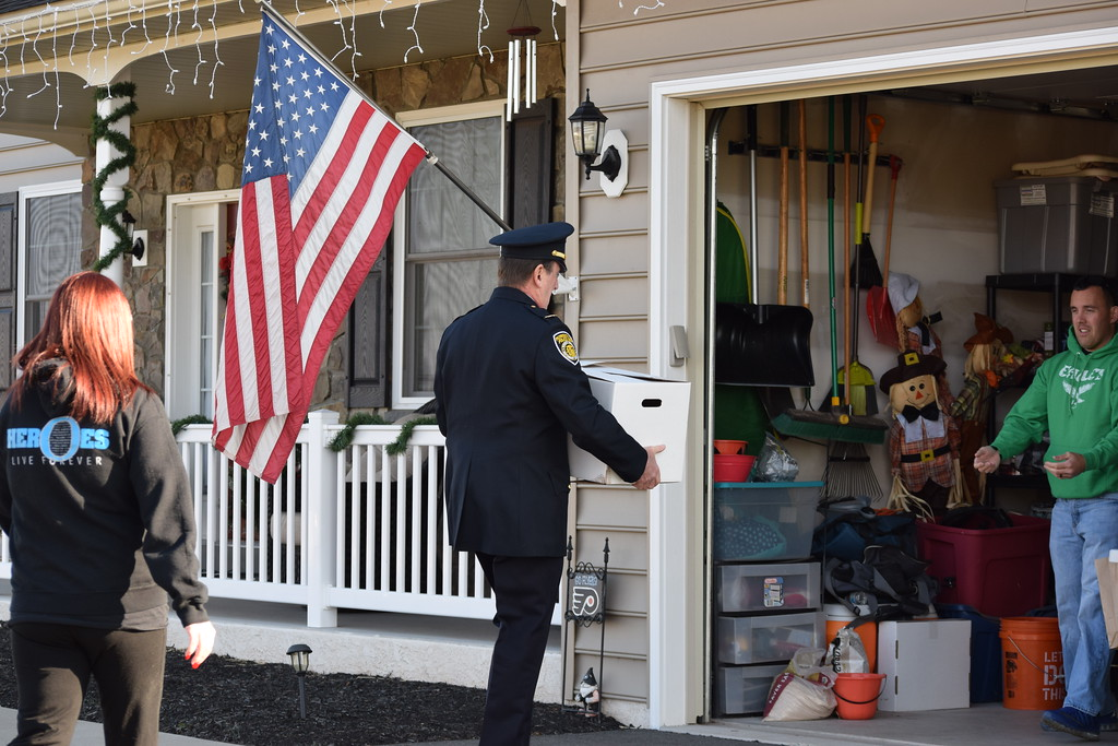 . Plymouth Township Police chief Joseph Lawrence delivers a box from Meals on Wheels to the Fox family home in Gilbertsville. Marian Dennis -- Digital First Media