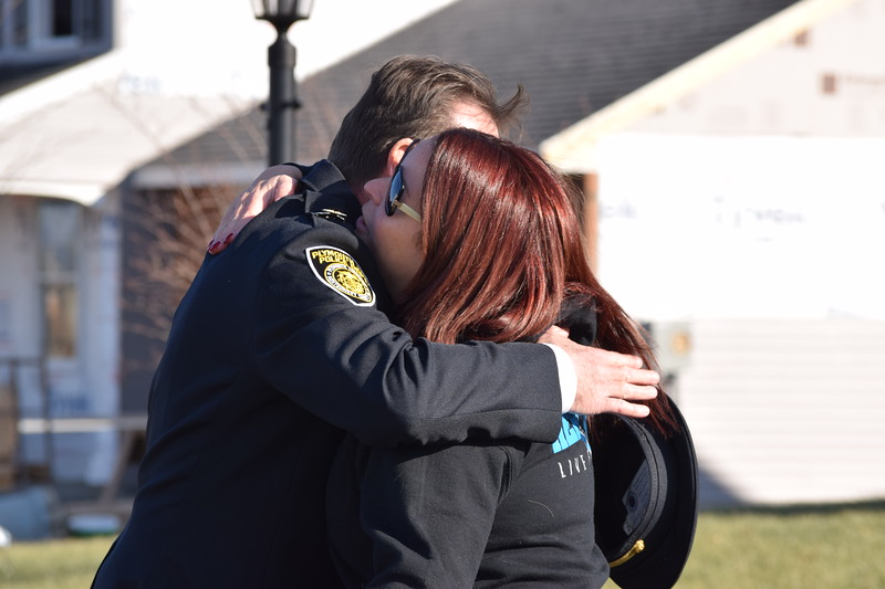 Plymouth Township Police and several other police departments were met with warm embraces as they visited the family of slain Plymouth Township officer Brad Fox.<br /> Marian Dennis -- Digital First Media