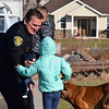 Plymouth Township Police Chief Joseph Lawrence is greeted with hugs by Kadence and Brad Jr., the children of fallen Plymouth Township Police Office Brad Fox. The police department, along with several others made a special visit to the family for a holiday Meals on Wheels.<br /> Marian Dennis--Digital First media