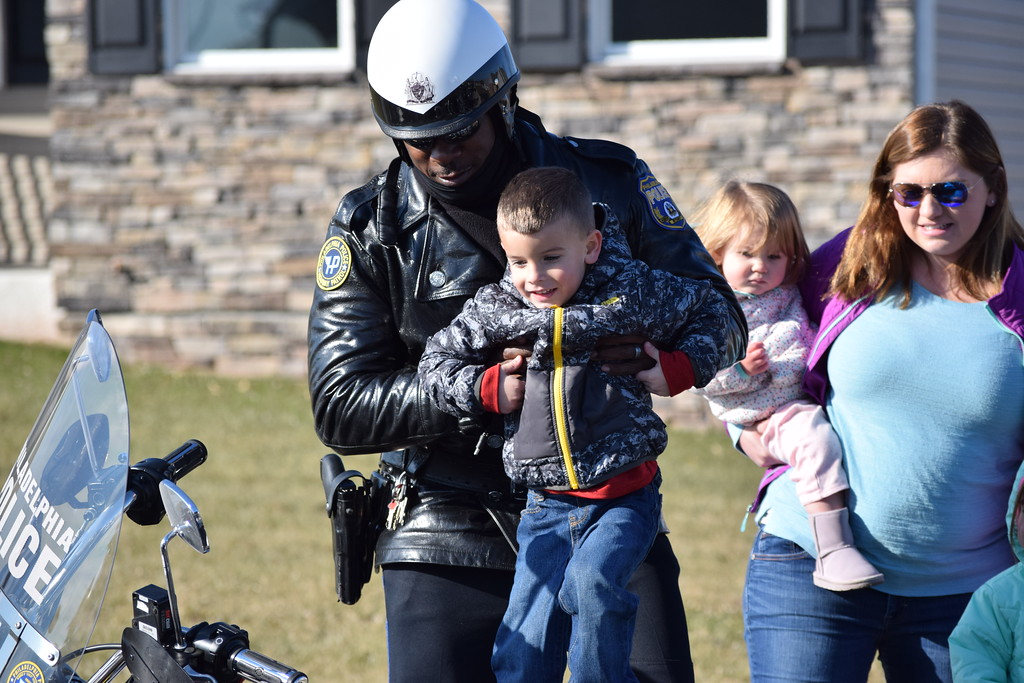 . Brad Fox Jr. takes a turn sitting on one of the police motorcycles that paraded down Fox Lane in Gilbertsville Thursday as they visited the Fox family. Marian Dennis -- Digital First Media