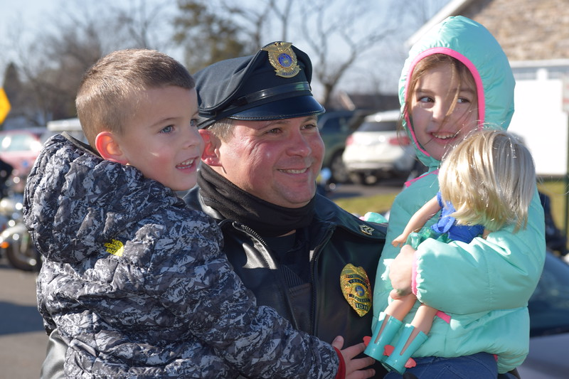 Police made a special stop with Meals on Wheels Thursday to the Gilbertsville home of fallen officer Brad Fox's family. Officers from Plymouth Township as well as many other area departments stopped by to deliver food and visit.<br /> Marian Dennis -- Digital First Media