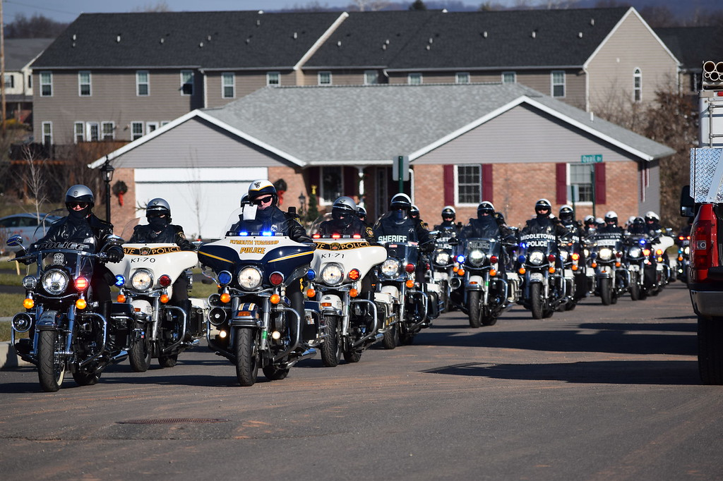 . Police motorcycles filled Fox Lane in Gilbertsville Thursday as area police departments made a special Meals on Wheels delivery to the Fox family. Marian Dennis-- Digital First Media