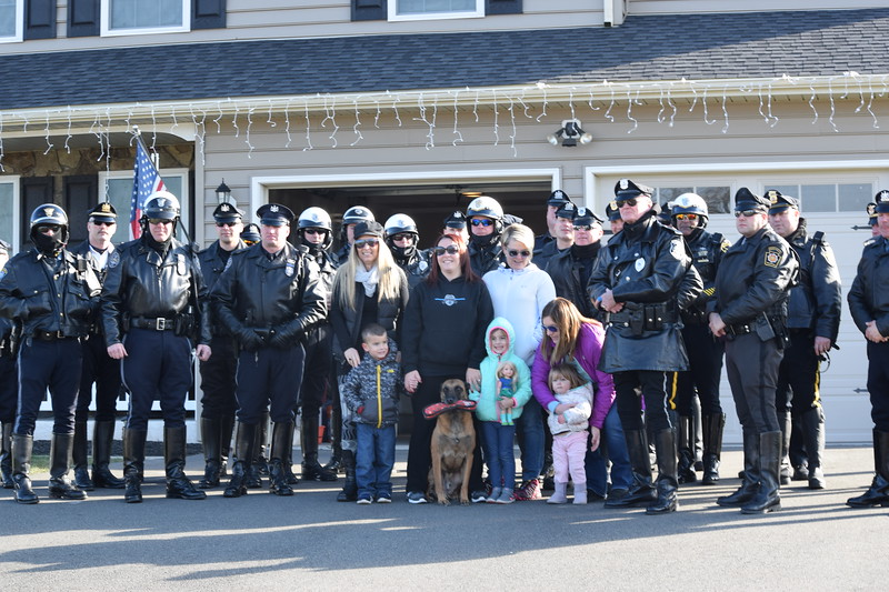 Officers came to the Fox home in Gilbertsville to visit fallen Plymouth Township officer Brad Fox's family. The visit was part of a Meals on Wheels event that was specifically tailored to families of fallen law enforcement officers.<br /> Marian Dennis -- Digital First Media