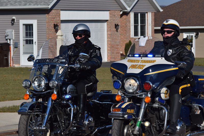Plymouth Township Police and several other area departments processed on motorcycles down Fox Lane in Gilbertsville to deliver food and visit with the family of fallen Plymouth Township police officer Brad Fox.<br /> Marian Dennis--Digital First Media