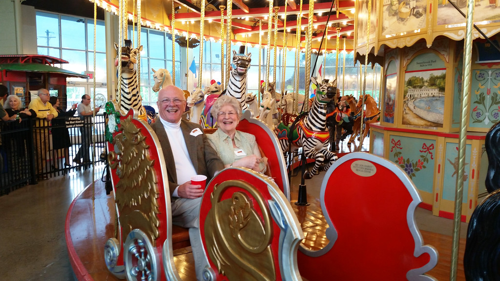 . Dr. John Dolan and his wife Nancy take a ride in the handicapped-accessible chariot he built and donated to the Carousel at Pottstown during the organization\'s Appreciation Night on May 4.
