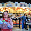 Rainbow the Clown makes a balloon as the Carousel at Pottstown spins in the background....Photo/Tom Kelly III