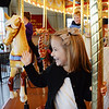 Ava Buttaro from Pottstown waves to her dad while taking a ride on the Carousel at Pottstown....Photo/Tom Kelly III