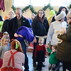 Children and adults line up to ride the Carousel at Pottstown during the opening day....Photo/Tom Kelly III