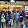 Children and adults line up to ride the Carousel at Pottstown and see Santa during the opening day....Photo/Tom Kelly III
