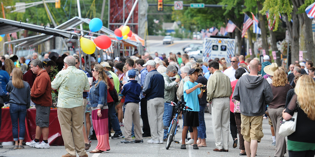 . John Strickler - The Mercury Lines of area residents were on High Street in downtown Pottstown snacking of the varieties of foods prepared by local restaurants at the 12th annual Carousel of Flavor.