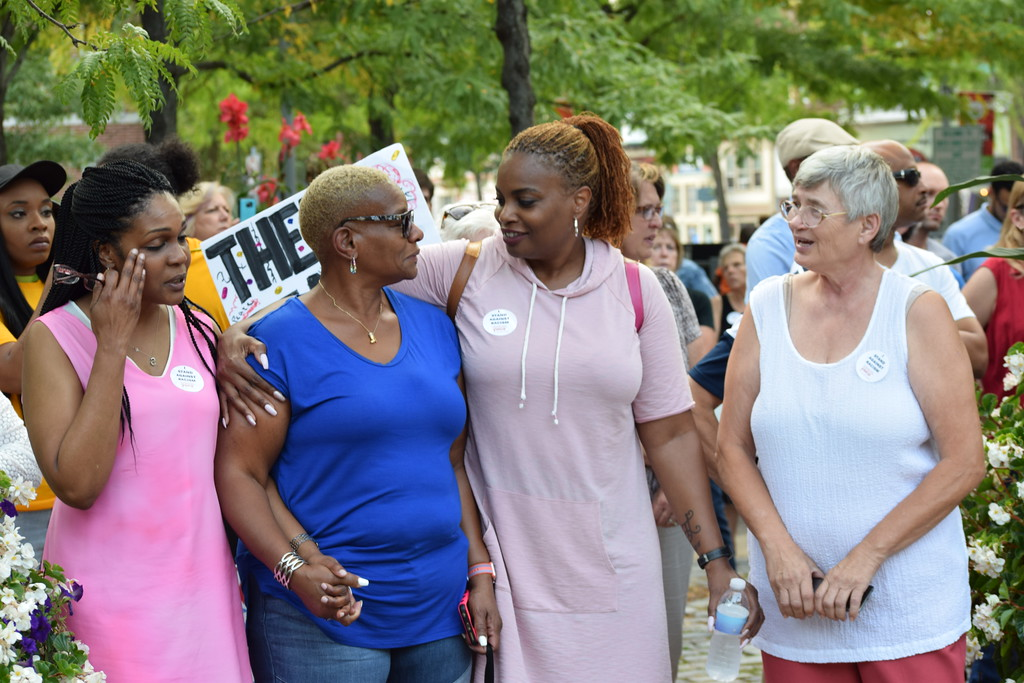 . Attendees at the Pottstown vigil for Charlottesville embraced as the crowd sang a rendition of �We Shall Overcome.� Marian Dennis -- Digital First Media