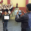 Evan Brandt -- Digital First Media<br /> Sudhakar Akasapu takes a photo of his wife Sirisha Devi Akasapu after Monday's citizenship ceremony. Both are among the 54 new citizens sworn in at Pottsgrove High School.