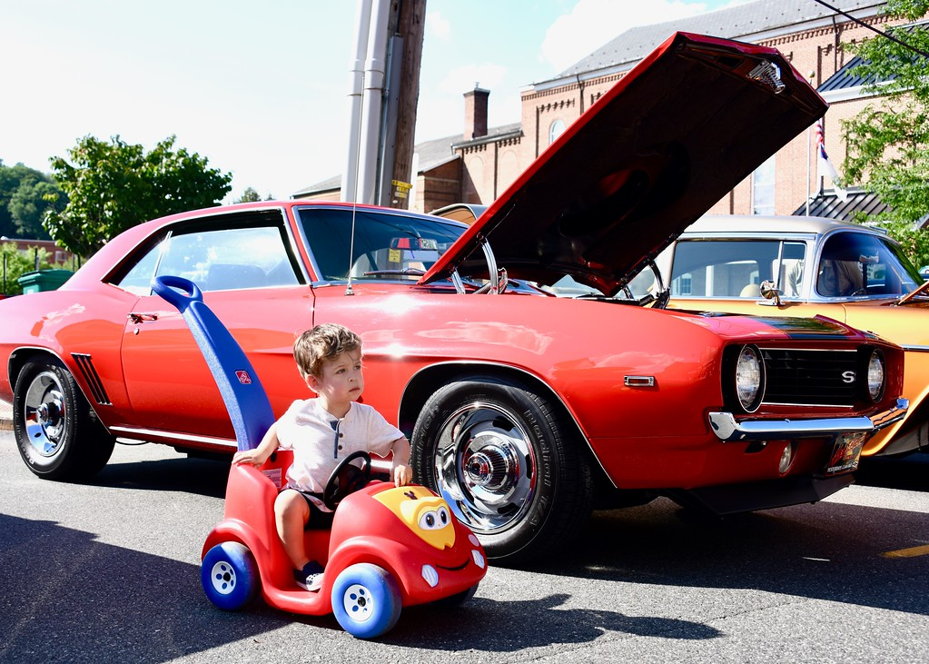 . Jesi Yost - Digital First Media  Roman Rhude, 2, of Boyertown parks his ride along side of cars on Reading Avenue, Boyertown, during the 11th Annual Cruise Night on July 28.