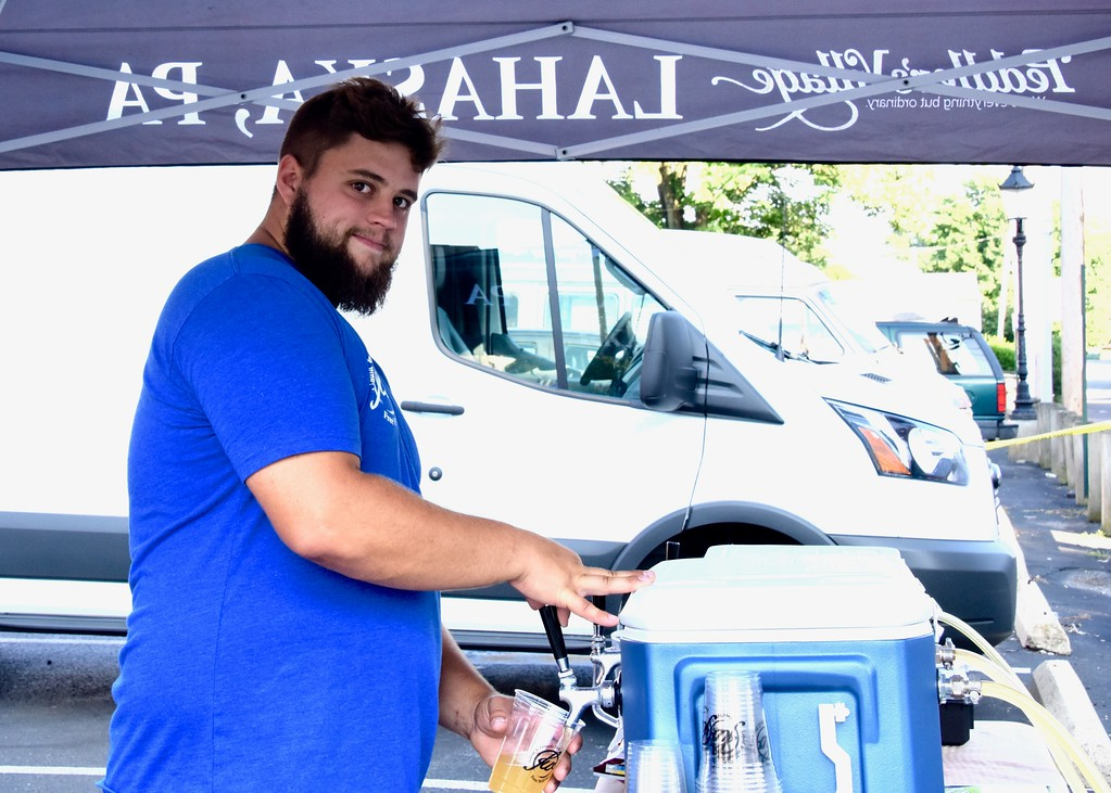 . Jesi Yost - Digital First Media  Zach Neff serves up beer from the Free Will Brewing Co. Beer Garden.