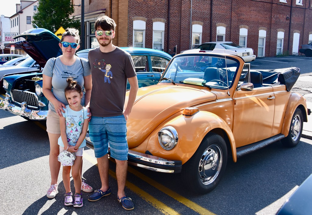 . Jesi Yost - Digital First Media  Helen, Ryan and Breanne Evans, 6, of Boyertown pose in front of a 1978 Volkswagen Super Beetle during the 2018 Boyertown Cruise Night on July 28.