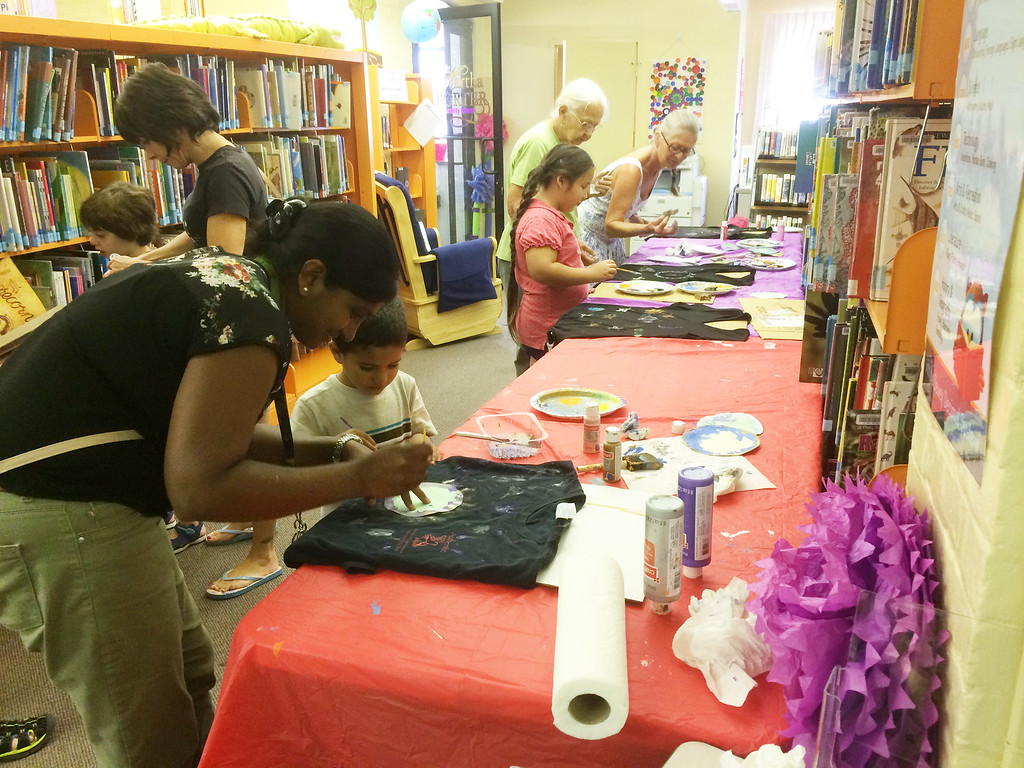 . A table filled with painting activities with the eclipse theme was set up at the Pottstown Library for their Galaxy Painting Party Friday. Photo by Evan Brandt - Digital First Media