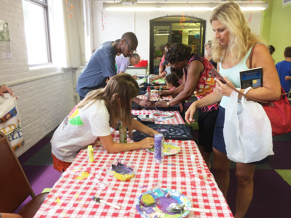 . Children and adults from around the region participated in the Pottstown Library\'s Galaxy Painting Party Friday. Photo by Evan Brandt - Digital First Media
