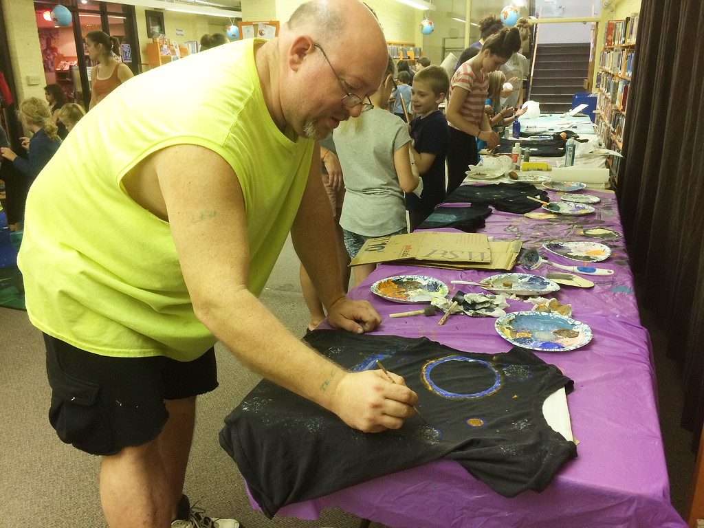 . Michael Heffner of Boyertown was one of the hundreds who came out to take part in the Pottstown Library\'s Galaxy Painting Party Friday. Photo by Evan Brandt - Digital First Media
