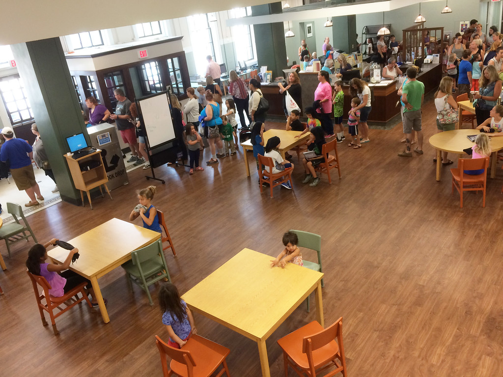 . The line of library visitors was long as families waiting to participate in the Pottstown Library\'s Galaxy Painting Party Friday. Photo by Evan Brandt - Digital First Media
