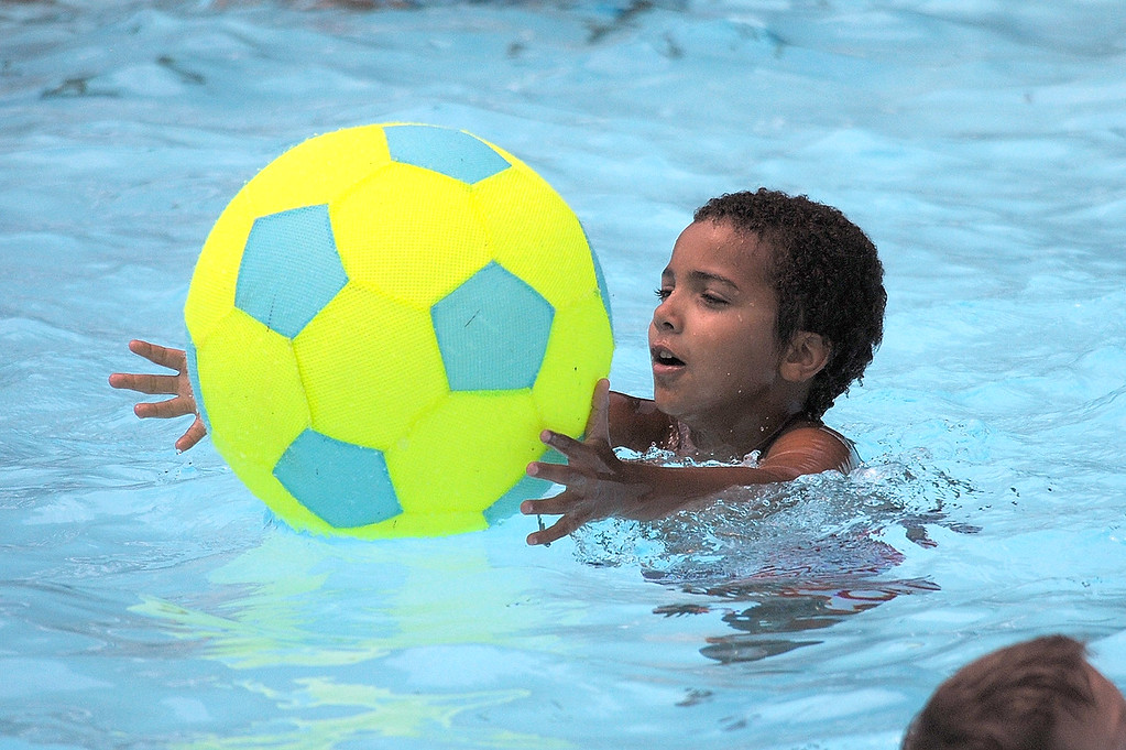 . Gene Walsh � Digital First Media Child plays a game of catch in the pool at North End Swim Club in Pottstown August 1, 2017.