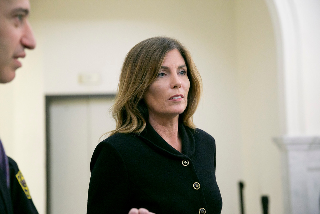 . Pennsylvania Attorney General Kathleen Kane leaves the courtroom after closing arguments in her perjury and obstruction trial at the Montgomery County Courthouse, Monday, Aug. 15, 2016, in Norristown, Pa., (Jessica Griffin/The Philadelphia Inquirer via AP, Pool)