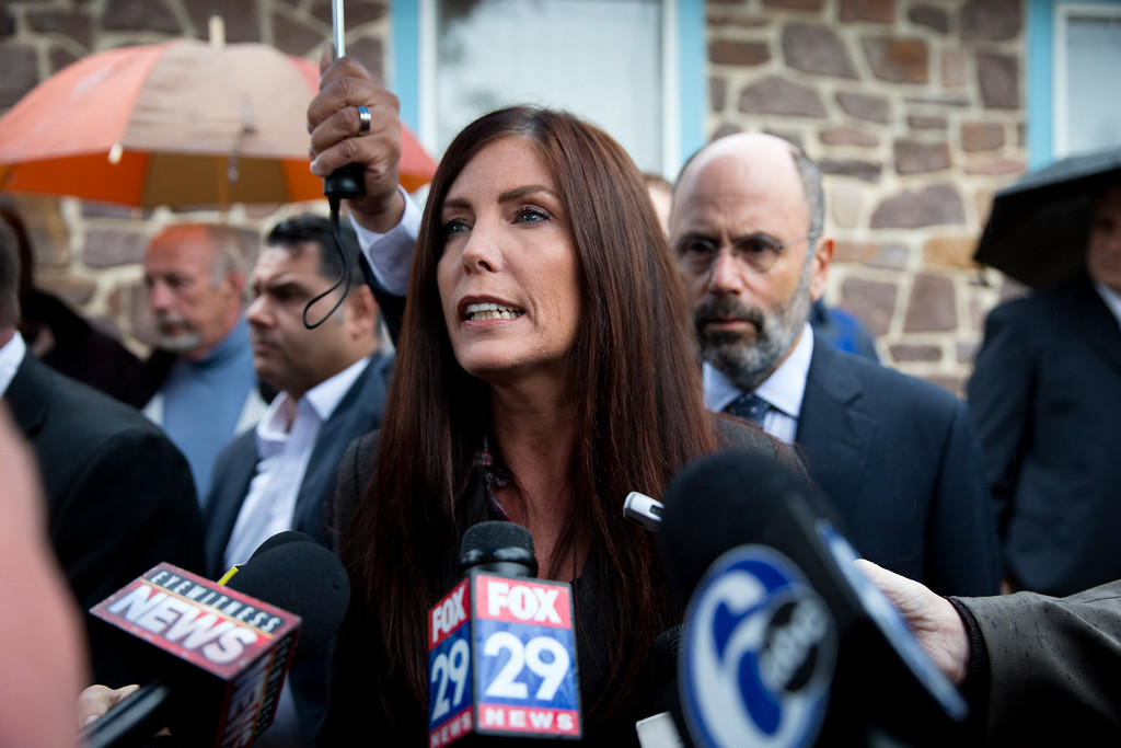 . Pennsylvania Attorney General Kathleen Kane speaks with members of the media after her arrangement before a district judge, Thursday, Oct. 1, 2015, in Collegeville, Pa. Prosecutors added a new perjury count and other criminal charges Thursday against Kane, saying they found a signed document that contradicts her claims she never agreed to maintain secrecy of a grand jury investigation in 2009, before she took office. The Montgomery County district attorney charged her with felony perjury and two misdemeanors � false swearing and obstruction � based on a signed secrecy oath she signed shortly after taking office in early 2013. AP Photo/Matt Rourke)