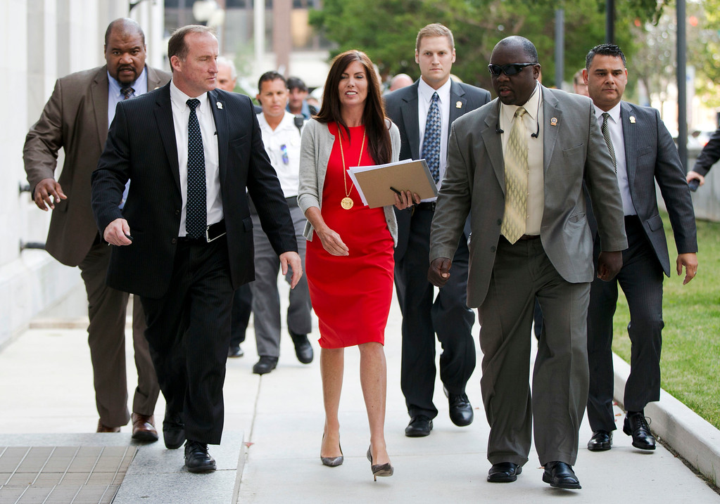 . Pennsylvania Attorney General Kathleen Kane, center, departs after her preliminary hearing Monday, Aug. 24, 2015, at the Montgomery County courthouse in Norristown, Pa. Kane is accused of leaking secret grand jury information to the press, lying under oath and ordering aides to illegally snoop through computer files to keep tabs on an investigation into the leak. (AP Photo/Matt Rourke)