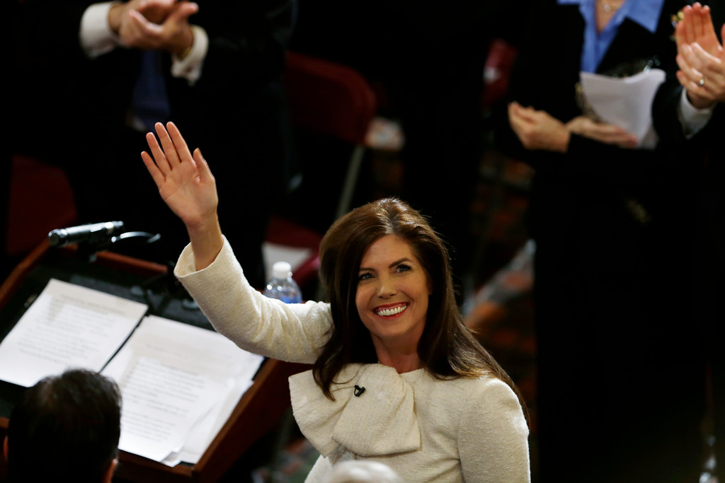 . Pennsylvania Attorney General Kathleen Kane waves after she took her oath of office at the state Capitol in Tuesday, Jan. 15, 2013, in Harrisburg, Pa. Kane is first woman and first Democrat to be elected Pennsylvania attorney general. (AP Photo/Matt Rourke)