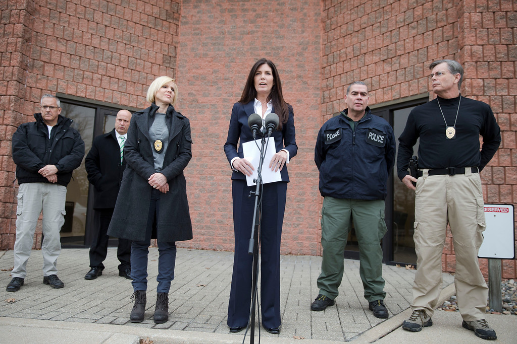 . Attorney General Kathleen Kane, center, speaks during a news conference Wednesday, Jan. 21, 2015, in Philadelphia. Court documents released Wednesday show a grand jury has concluded there are reasonable grounds to charge Kane with perjury, false swearing, official oppression and obstruction after an investigation into leaks of secret grand jury material. In an unrelated public appearance Wednesday in Philadelphia, Kane maintained her innocence. (AP Photo/Matt Rourke)