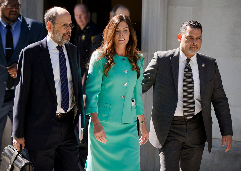 . Pennsylvania Attorney General Kathleen Kane, center, accompanied by her attorney Gerald Shargel, left, departs after a pretrial hearing in her grand jury leak case, Wednesday, April 20, 2016, at the Montgomery County courthouse in Norristown, Pa. Kane is accused of leaking secret grand jury information to the press, lying under oath and ordering aides to illegally snoop through computer files to keep tabs on an investigation into the leak. (AP Photo/Matt Rourke)