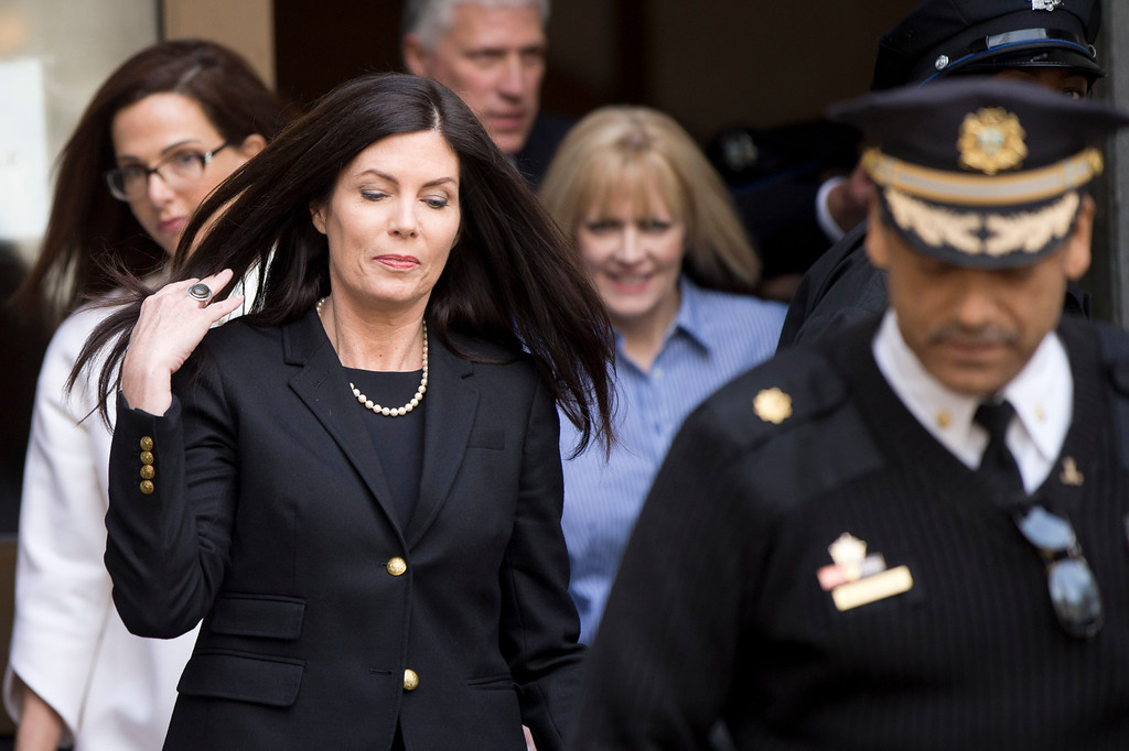 . Pennsylvania Attorney General Kathleen Kane walks to her vehicle, Wednesday, March 11, 2015, from the State Supreme Court room at City Hall in Philadelphia. The court heard arguments on the legality of a special prosecutor who led a grand jury investigation. The grand jury has recommended charges against her.  (AP Photo/Matt Rourke)