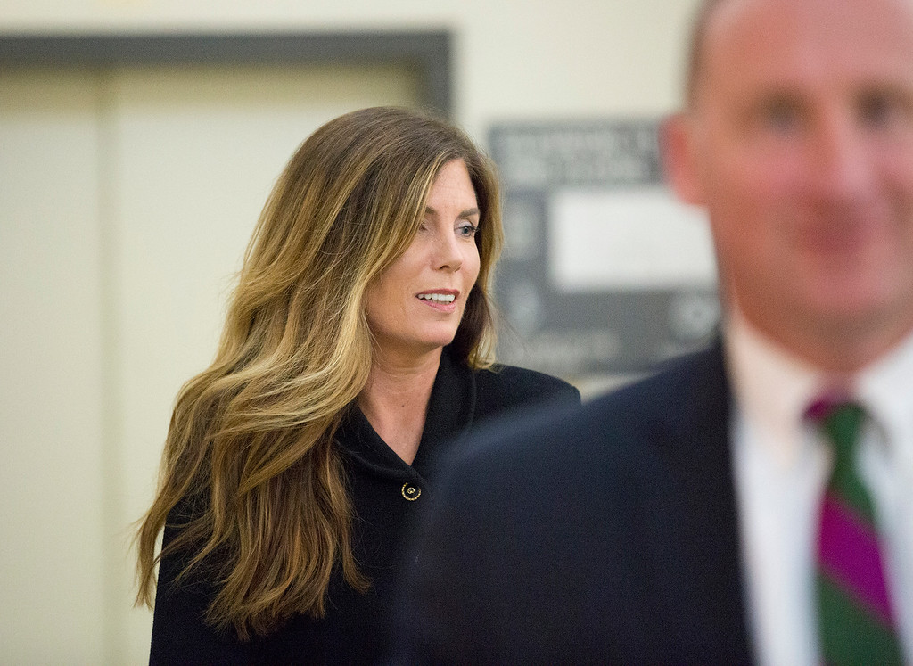 . Pennsylvania Attorney General Kathleen Kane walks down a hallway to re-enter the courtroom after a lunch break at the Montgomery County Courthouse, Monday, Aug. 15, 2016, in Norristown, Pa., during closing arguments in her perjury and obstruction trial. (Jessica Griffin/The Philadelphia Inquirer via AP, Pool)