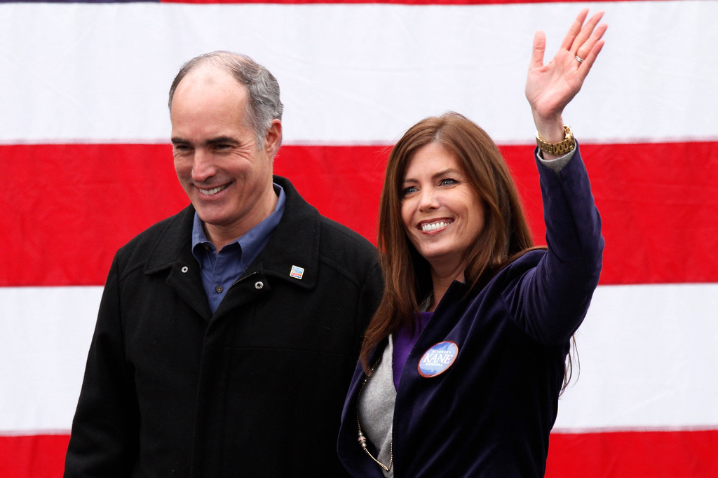 . U.S. Sen. Bob Casey, D-Pa., left, introduces democratic candidate for Pennsylvania Attorney General Kathleen Kane during a rally to get out the vote for President Obama in downtown Pittsburgh Monday, Nov. 5, 2012. (AP Photo/Gene J. Puskar)
