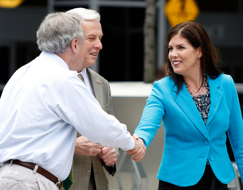 . Kathleen Kane, right, a candidate in the Democratic primary race for Pennsylvania state attorney general, greets a supporter, left, as she arrives before a news conference where Pennsylvania Auditor General Jack Wagner, center, endorsed Kane onThursday, April 19, 2012, in Pittsburgh. (AP Photo/Keith Srakocic)