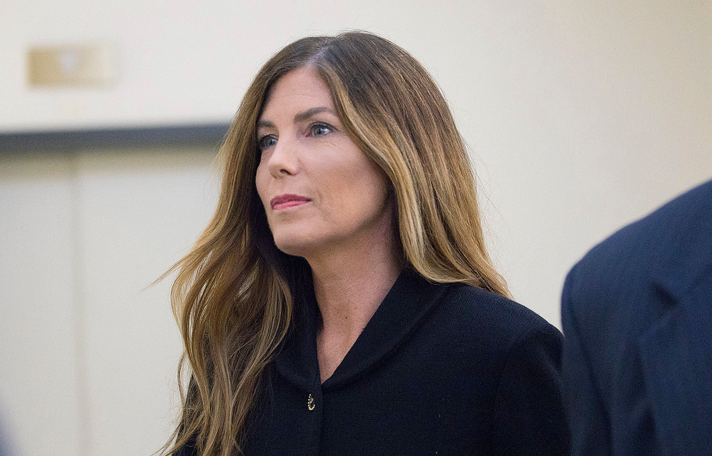. Pennsylvania Attorney General Kathleen Kane enters a courtroom at the Montgomery County Courthouse, Monday, Aug. 15, 2016, in Norristown, Pa., where closing arguments are expected during her perjury and obstruction trial. (Jessica Griffin/The Philadelphia Inquirer via AP, Pool)