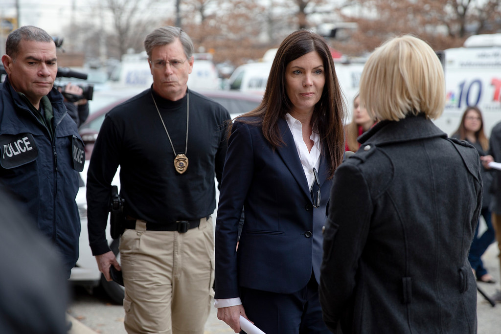 . Attorney General Kathleen Kane, center right, walks away at the end of news conference Wednesday, Jan. 21, 2015, in Philadelphia. Court documents released Wednesday show a grand jury has concluded there are reasonable grounds to charge Kane with perjury, false swearing, official oppression and obstruction after an investigation into leaks of secret grand jury material. In an unrelated public appearance Wednesday in Philadelphia, Kane maintained her innocence. (AP Photo/Matt Rourke)