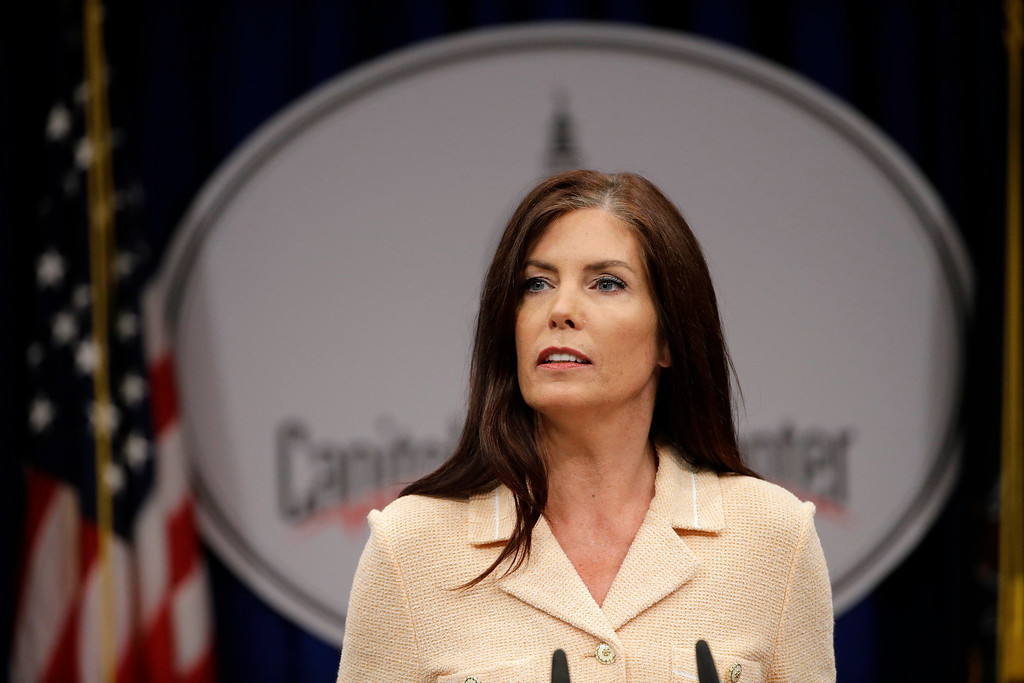 . Pennsylvania Attorney General Kathleen Kane speaks during a news conference, Wednesday, Aug. 12, 2015, at the state Capitol in Harrisburg, Pa. Kane said that criminal charges against her are part of an effort by state prosecutors and judges to conceal pornographic and racially insensitive emails they circulated with one another. Kane is charged with leaking grand jury information to a newspaper reporter as payback to a former state prosecutor and then lying about it under oath. (AP Photo/Matt Rourke)