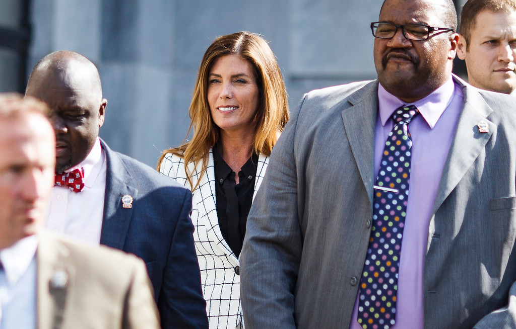 . Pennsylvania Attorney General Kathleen Kane leaves court after the second day of her trial at the Montgomery County Courthouse in Norristown, Pa. Tuesday, Aug. 9, 2016. Kane faces perjury and other charges related to the alleged leak of secret grand jury materials. (Dan Gleiter/PennLive.com via AP, Pool)