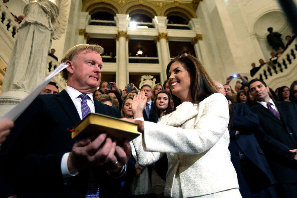 . Kathleen Kane accompanied by her husband Chris takes the oath of office for Pennsylvania Attorney General at the state Capitol, Tuesday, Jan. 15, 2013, in Harrisburg, Pa. Kane is first woman and first Democrat to be elected Pennsylvania attorney general. (AP Photo/Matt Rourke)