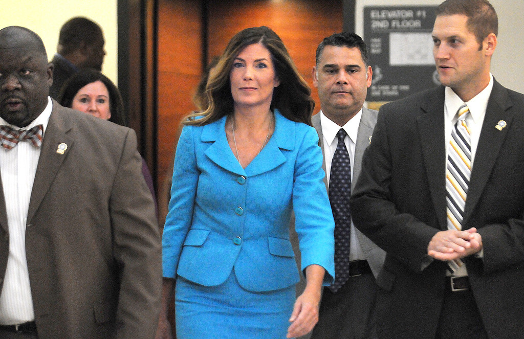 . Pennsylvania Attorney General Kathleen Kane enters the Montgomery County courtroom on Thursday, August 11, 2016 to continue her trial in Norristown, Pa. Kane, a first-term Democrat, is accused of leaking secret grand jury documents to the press and lying about it under oath. (Art Gentile/Bucks County Courier Times via AP, Pool)
