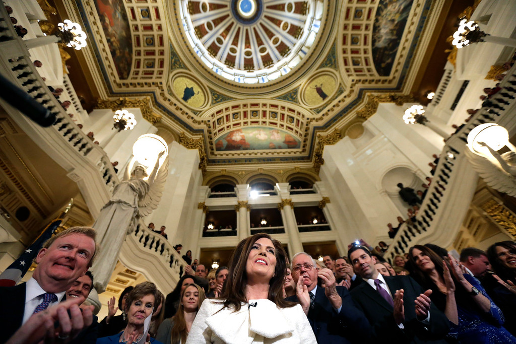. Kathleen Kane takes arrives to applause to take the oath of office for Pennsylvania Attorney General at the state Capitol, Tuesday, Jan. 15, 2013, in Harrisburg, Pa. Kane is first woman and first Democrat to be elected Pennsylvania attorney general. (AP Photo/Matt Rourke)